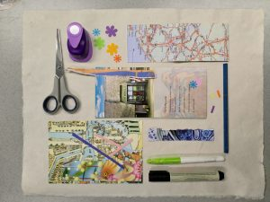 schaar, vele soorten papier, lijm alle ingrediënten voor de cursus
